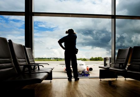 A male waiting sleeping in the airport photo