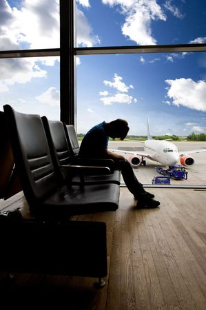 A male waiting sleeping in the airport Stock Photo - 3418693