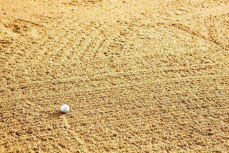 traps: A golf ball in a sand trap