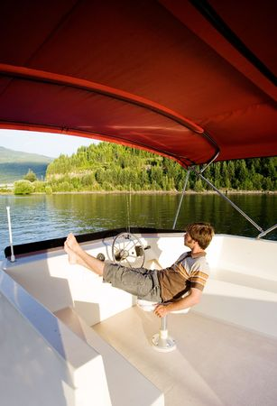 A young male enjoying a luxury boat photo