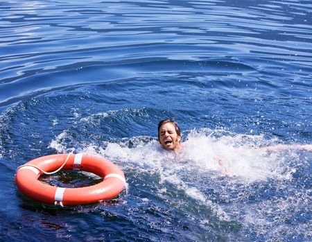 gasp: A man struggling for a life buoy in the water