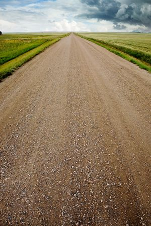 A prairie storm and a gravel road photo