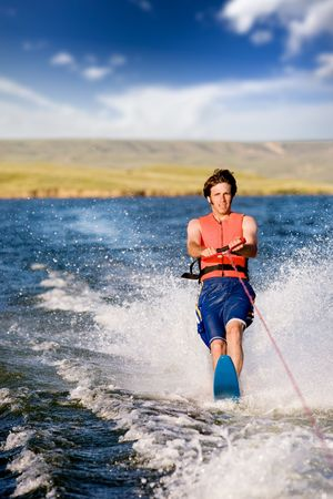 water skier: A man water skiing on a lake