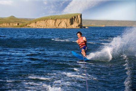 A man water skiing on a lake photo