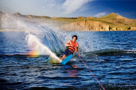 A male waterskiing on a beautiful lake photo