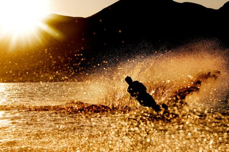 water skiing: A male waterskiing in the evening sunset Stock Photo