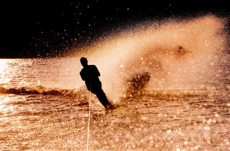 water skier: Silhouette of a water skier