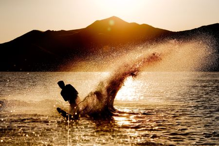 Silhouette of a water skier photo