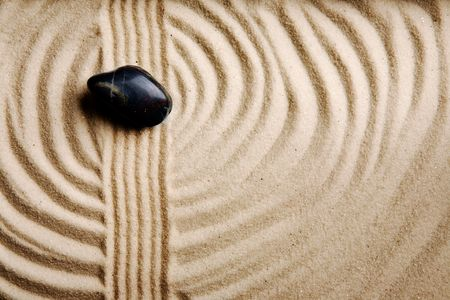 raked: A circular sand swirl background texture abstract