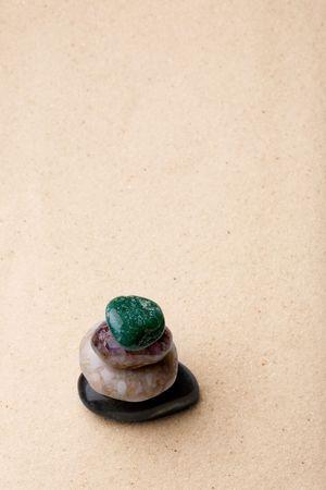 raked: A tower of rocks in a very minimalist zen rock garden Stock Photo