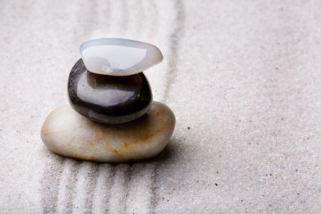 tower of rocks in a sand zen rock garden Stock Photo - 3530900