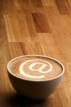 A cappuccino with an @ sybol in the milk
