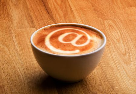 capucinno: A cappuccino with an @ sybol in the milk