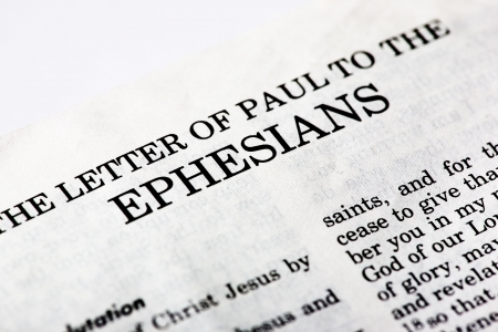 A macro detail of the book of Ephesians in the Christian New Testament