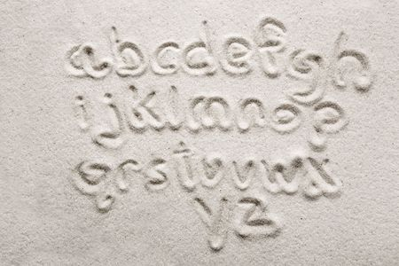 lower case alphabet written in sand - a designers tool photo