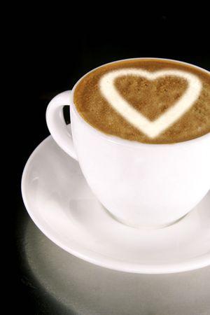 cappuccio: A heart on a creamy cup of cappucinno Stock Photo