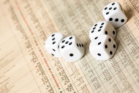 Dice and stock market charts in the newspaper photo