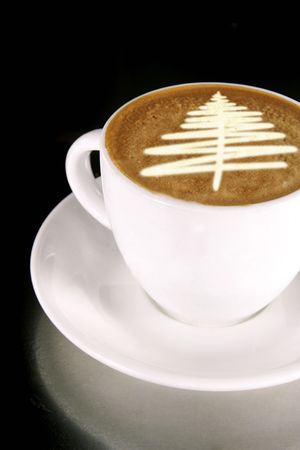 A cappuccino with a christmas tree in latte art photo
