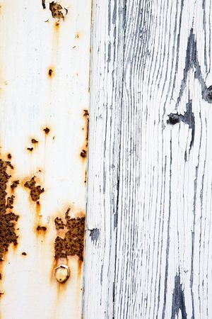 rusting: And old door with weathered white paint and rusting metal Stock Photo