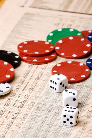 dice and casino chips on a stock market chart photo