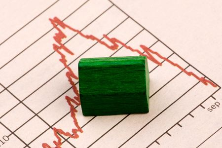 unstable: Housing market concept image with graph and toy house Stock Photo