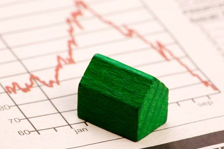 collapsed: Housing market concept image with graph and toy house Stock Photo