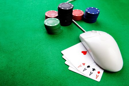 Online gaming and gambling concept, green felt, a mouse and cards photo