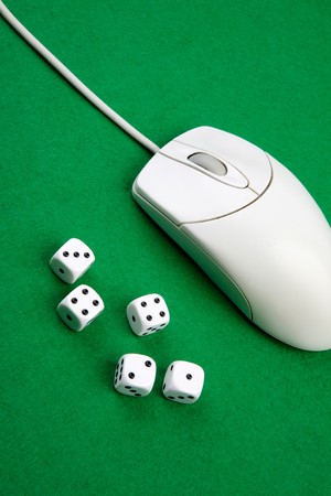 gambling parlour: Dice and a computer mouse on a green background. - Online Gaming concept