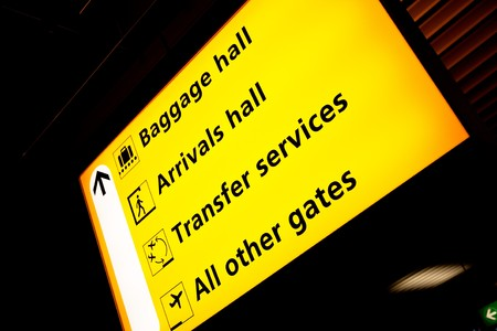 A sign at an aiport with directions to various services photo