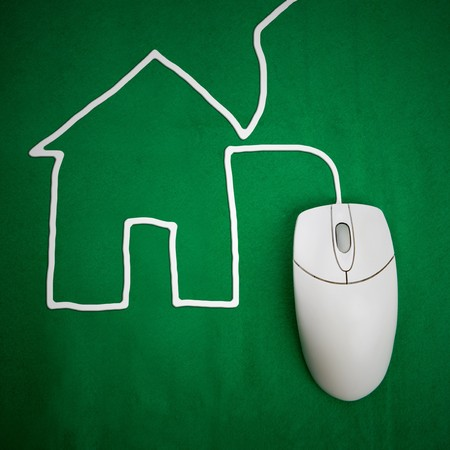 A housing concept with computer mouse and cord in the shape of a house