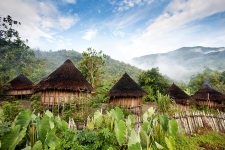 papua new guinea: A traditional hut in an Indonesian mountain village Stock Photo