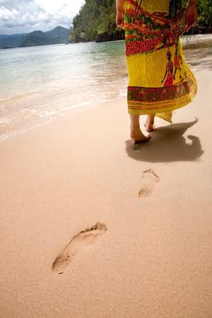 adult footprint: A female walking on the beach