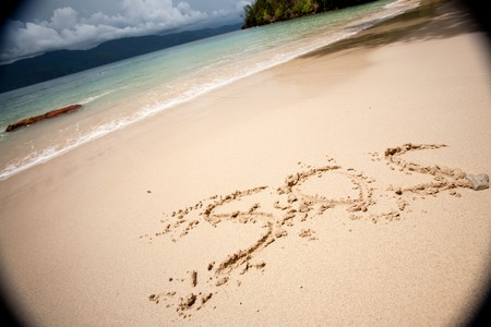mood moody: SOS written in the sand with a strong moody vignette