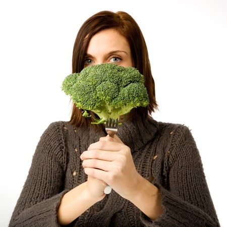 brocolli: A woman ready to eat broccoli Stock Photo