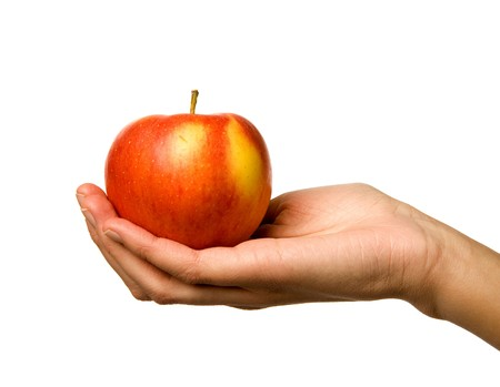 A handing holding out an apple Stock Photo - 4554845