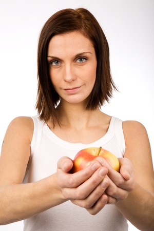 A young woman holding an apple photo