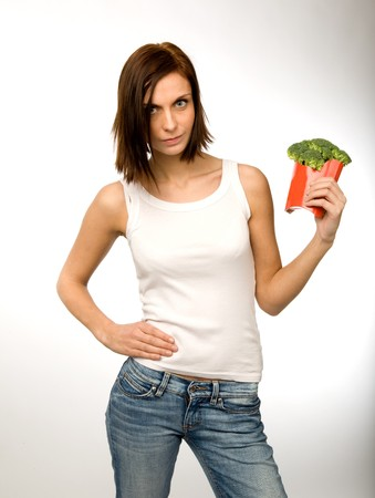A woman holding broccoli in a french fry container Stock Photo