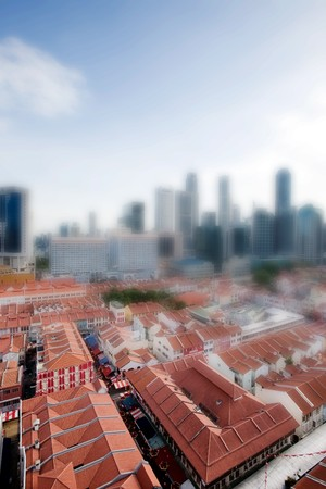 Chinatown with Singapore city center in the background taken with a tilt shift lens photo