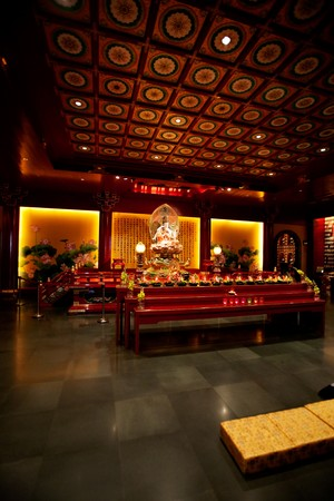 An interior of a buddhist temple with low lighting