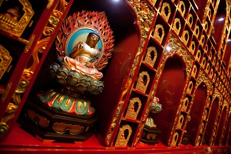 An interior of a buddhist temple with many Buddha statues. Stok Fotoğraf