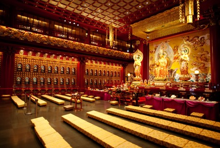 An interior of a Buddhist temple with a Buddha statue