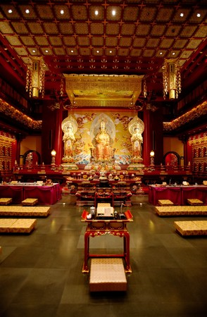 An interior of a Buddhist temple with a Buddha statue photo