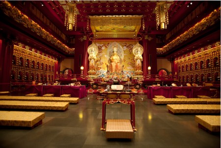 Interior of a Buddhist temple with many statues photo