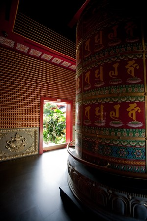 Interior of a Buddhist temple with a prayer wheel