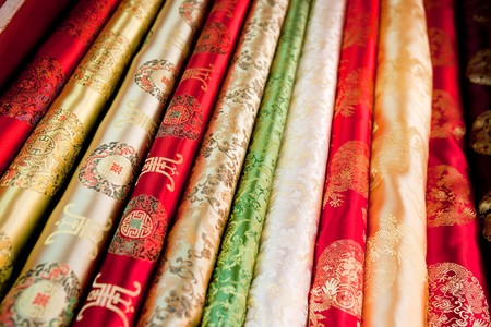 fabric roll: A collection of asian cloth on the roll background pattern Stock Photo