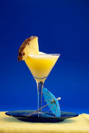 A refreshing summer drunk - pina colada over a blue background photo