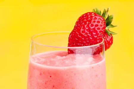 A fresh strawberry smoothie isolated over yellow Stock Photo - 4742699