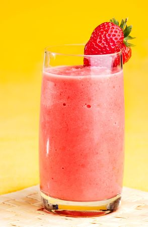 A fresh strawberry smoothie isolated over yellow photo
