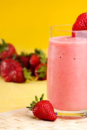 frappe: A fresh summer strawberry drink isolated on yellow Stock Photo