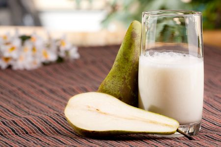 tall glass: A tall glass of pear smoothie in a natural setting Stock Photo